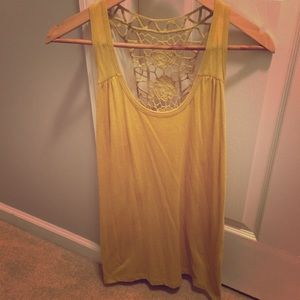 Anthropologie sleeveless tank top with lace back.